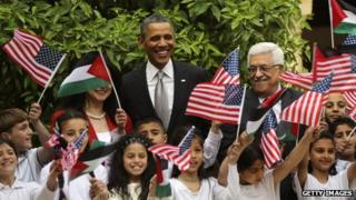 Barack Obama (C) poses Palestinian children during a visit to the Church of the Nativity with Palestinian President Mahmoud Abbas (R) in Bethlehem, West Bank, 22 March 2013