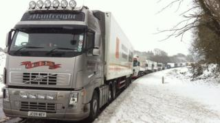 A train of lorries stuck on the A75 at Newton Stewart