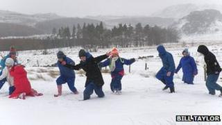 Pupils of Westleigh Methodist School playing in snow at Hinning House