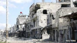 A view is seen of damaged buildings at Baba Amr neighborhood in Homs city, 27 March 2013