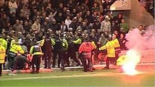 Flare thrown on pitch at Plymouth v Exeter match