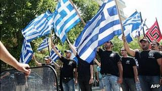 Golden Dawn activists in black shirts - file pic