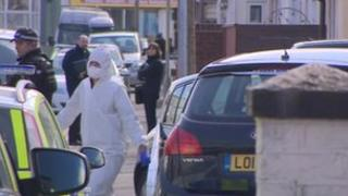 Police and forensic officers in Tredworth, Gloucester