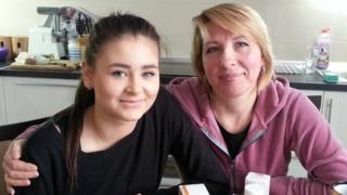 Liza Yaroshenko with her adoptive mother Oksana Aligeva