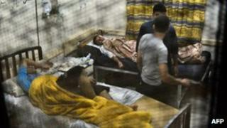 Egyptian students from the al-Azhar University rest in a hospital in Cairo.