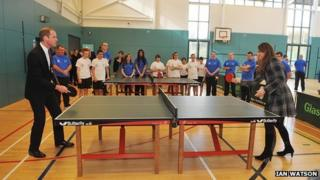 Prince William and Catherine playing table tennis