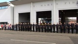 Firefighters and members of the public lined up outside St Mary's Fire Station for the two-minute silence