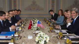 US Secretary of State John Kerry (right, foreground) faces Turkish Foreign Minister Ahmet Davutoglu (opposite) at talks in Istanbul, 7 April
