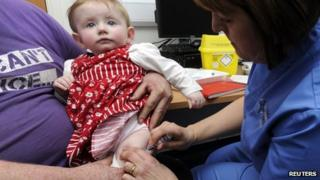 A child is given an MMR injection at the Paediatric Outpatients department at Morriston Hospital in Swansea