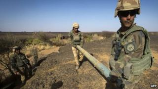 French soldiers from the 92nd Infantry Regiment carry a rocket in the Gao region on 7 April 2013