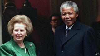 A picture dated 4 July 1990 shows South African anti-apartheid leader Nelson Mandela (R) shaking hands with then British Prime Minister Margaret Thatcher on the steps of No 10 Downing Street
