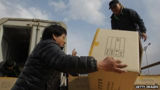 South Korean workers arrive with products from the Kaesong joint industrial complex in North Korea at the inter-Korean transit office in Paju, South Korea