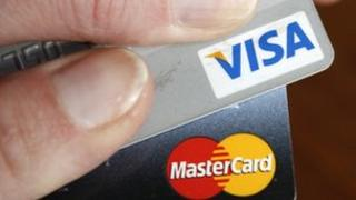The European Commission is investigating inter-bank fees charged by MasterCard and Visa