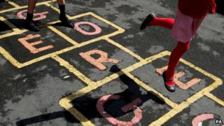 Schoolchildren playing hop-scotch