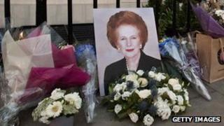 Flowers and mementos left by members of the public and admirers sit outside the home of former British Prime Minister Margaret Thatcher