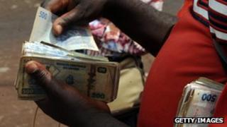 Money changer in Goma, Democratic Republic of Congo