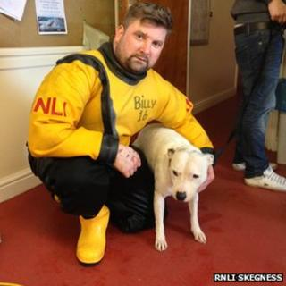 Storm the dog with crew member Billy Harrison