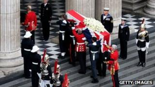 Members of the Armed Services carry the coffin up the steps during the Ceremonial funeral of former British Prime Minister Baroness Thatcher at St Paul's Cathedral