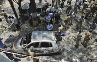 "Police and forensic officials inspect the scene of a blast near the office of India""s main opposition Bharatiya Janata Party (BJP) in the southern Indian city of Bangalore April 17, 2013."