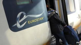 Passenger loading her bag onto a Eurostar train