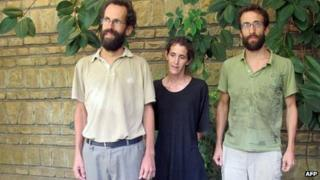 Former French hostages Tanguy Moulin-Fournier, his wife Albane and his brother Cyril pose at the French embassy in Yaounde on 19 April 2013