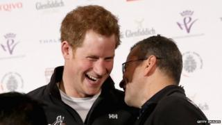 Prince Harry shares a joke with blind former soldier Ivan Castro