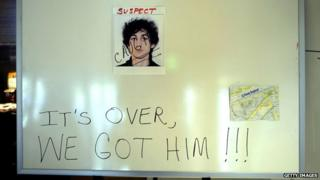"Sign in hotel lobby with photo of Dzhokhar Tsarnaev with caption ""It's over, we got him"""