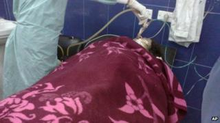 Woman treated in what rebels claim was chemical attack in Aleppo (April 13 2013 image provided by Aleppo Media Centre)