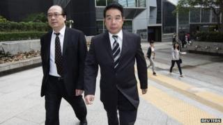 Birmingham City Football Club owner Carson Yeung (R) arrives at a district court in Hong Kong on Monday to answer money-laundering charges