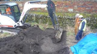 The archaeologists used a digger to excavate the original course of the railway