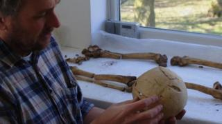 Tim Sutherland examining the skull