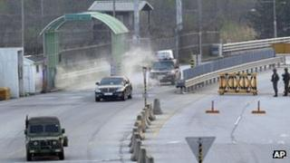 Vehicles returning from North Korea's Kaesong are escorted by a South Korean military vehicle at the customs, immigration and quarantine office near the border village of Panmunjom that separates the two Koreas, in Paju, north of Seoul, South Korea, 3 May 2013