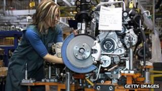 A worker builds an engine for a Ford Focus on the assembly line at Ford Motor's Michigan Assembly Plant in Wayne, Michigan.