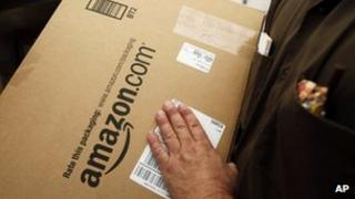 An Amazon.com package is prepared for shipment by a United Parcel Service driver in Palo Alto, California 18 October 2010 file photo