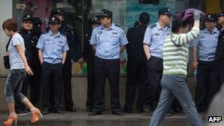 Policemen stand at the site of the 9 May 2013 protest on 9 May 2013