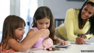 girls with piggy bank