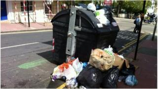 Overflowing rubbish bin in Brighton