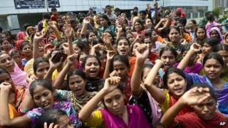 Garment workers shouts slogans during a protest for better working conditions more than a week after the collapse of Rana Plaza on 5 May
