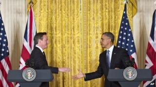 President Barack Obama and British Prime Minister David Cameron reach to shake hands at the end of their joint news conference 13 May 2013