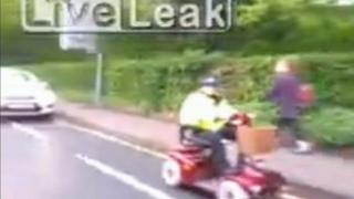 Mobility scooter escorted by Wiltshire police