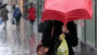 Shopper with umbrella