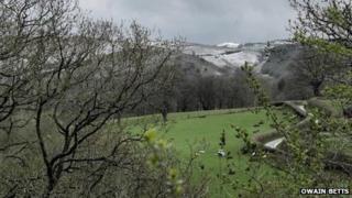 Snow on hills at Caersws