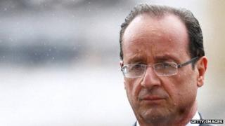Francois Hollande attends a ceremony in the rain to pay respect to the Unknown soldier at the Arc de Triomphe on 15 May 2012 in Paris.