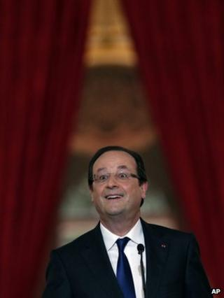 French President Francois Hollande addresses reporters in Paris, 16 May
