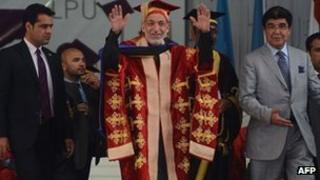 Afghanistan President Hamid Karzai (C) gestures during the 3rd convocation at Lovely Professional University (LPU) on the outskirts of Jalandhar on May 20,2013.
