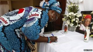 Mourner signs book of condolence in Ogidi. 23 May 2013