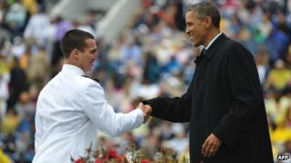 President Barack Obama congratulates a naval graduate in Annapolis, Maryland 24 May 2013