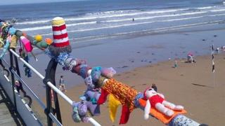 Knitting left by Saltburn 'yarnbombers'