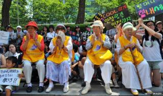 Former comfort women at a protest outside the Japanese Embassy in Seoul