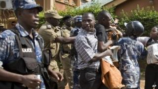 Media and members of Uganda's Human Rights Network for Journalists struggle with police as they protest outside the Daily Monitor newspaper head office, in Kampala, Uganda, 28 May 2013